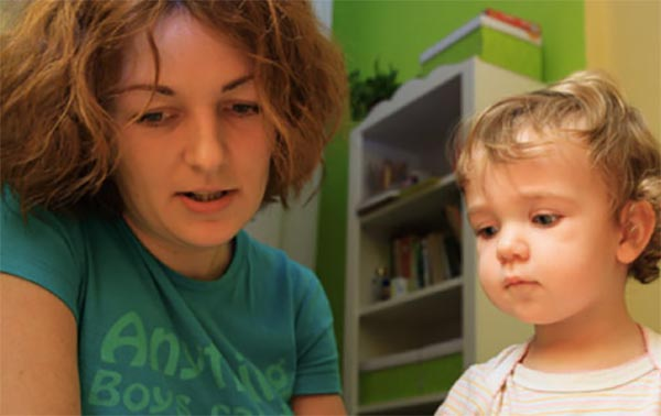 child autism uk woman teaching child